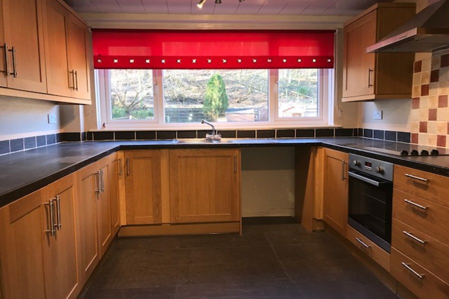 Fitted kitchen with built in hob, oven and cooker hood