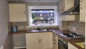 Fitted kitchen with oven and hob